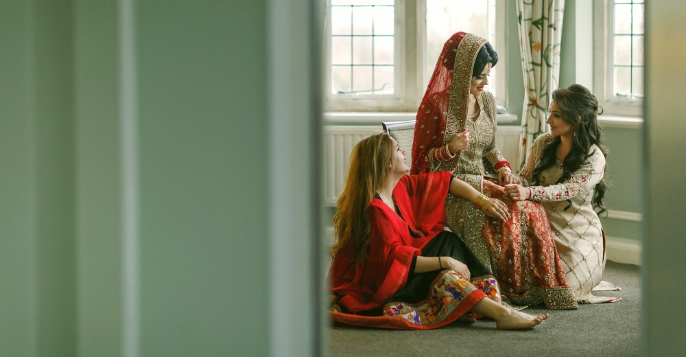 Bride with her sisters on her muslim wedding
